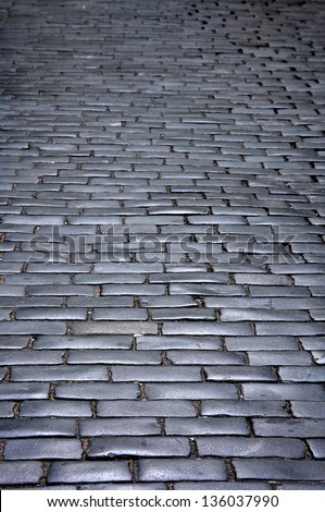 Cobbled road background - stock photo