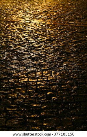 Cobbled street by night.