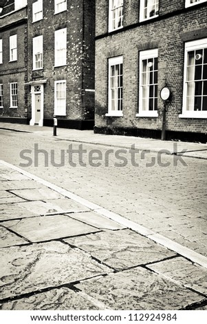 Cobbled street in an English town in monochrome