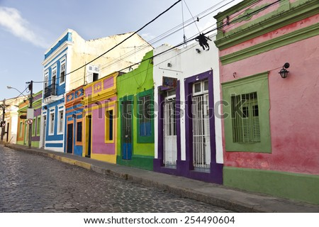 Cobbled street in historic Brazilian city Olinda with colonial architecture houses - stock photo