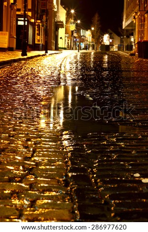 Cobbled street night rain