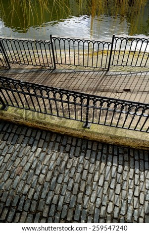 Cobbled street with metal fence in Camden Town, London - stock photo