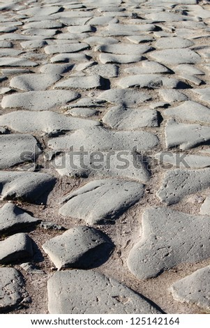 Cobblestone pavement in the Appian way of Rome, Italy - stock photo