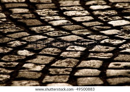 Cobblestone road closeup - stock photo
