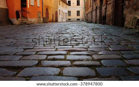 cobblestone, stone pavement texture in the city - stock photo