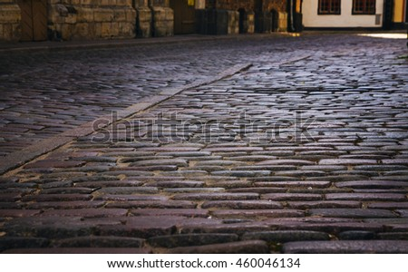 cobblestone, stone pavement texture in the city