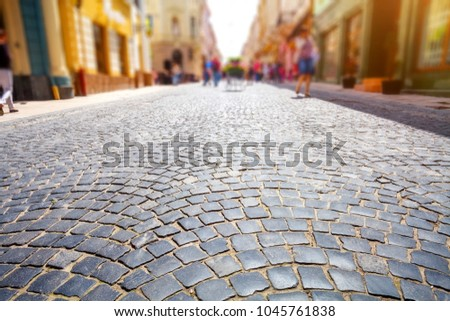 Cobblestone street in colorful old town. Sunny summer day