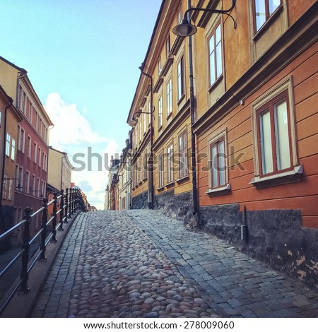 Cobblestone street with old buildings in Sodermalm, Stockholm. - stock photo