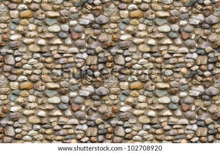 Cobblestone wall seamless background - stock photo