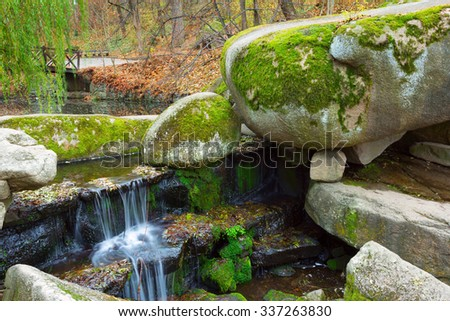 Cobblestones covered with moss in autumnal Sofiyivsky park in Uman, Ukraine - stock photo