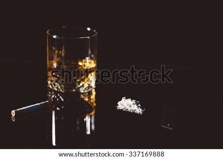 Cocaine, alcohol and five dollars  on glassy black background. - stock photo