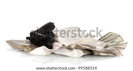 Cocaine and marijuana in packet with gun isolated on white - stock photo
