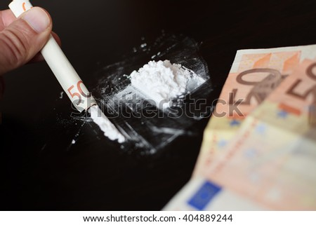 Cocaine and money blurred - stock photo