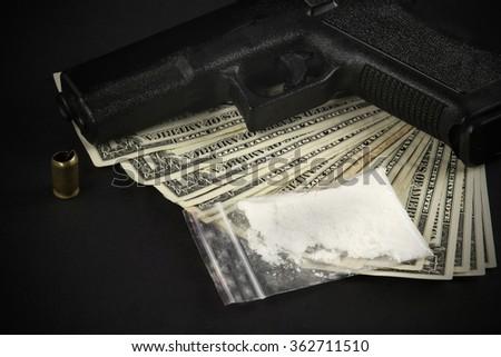 Cocaine, dollars,amo, weapon - stock photo