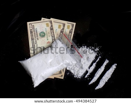 Cocaine drug powder in bag on dollar bills, cocaine pile and lines on white background