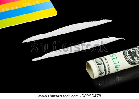 Cocaine, money and plastic card isolated on black background