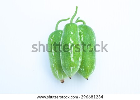Coccinia grandis raw green on a white background. Vegetables that produce all season. - stock photo