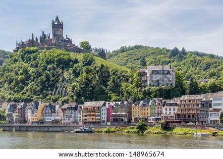 Cochem with castle along river Moselle in Germany - stock photo