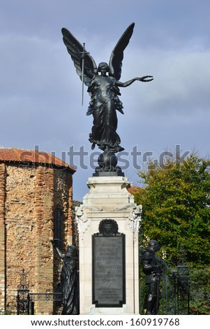 Cochester War Memorial with castle in background - stock photo
