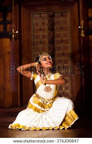 COCHIN, INDIA - JANUARY 21, 2016: Beautiful Indian girl dancing Mohinyattam (Dance of enchantress) in Fort Cochin, South India. Mohiniyattam is traditional South Indian dance from Kerala