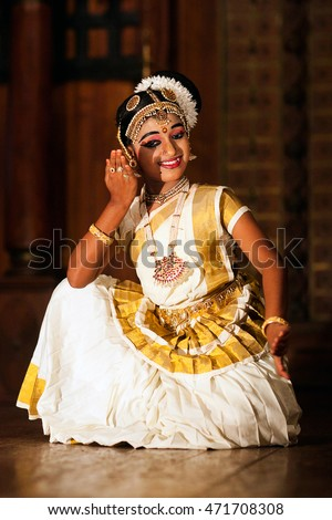 COCHIN, INDIA - JANUARY 21, 2016: Beautiful Indian girl in national clothes dancing Mohinyattam (Dance of enchantress) in Fort Cochin, Kerala.