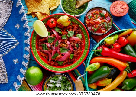 Cochinita Pibil Mexican platillo food with red onion and coriander - stock photo