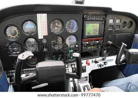 Cockpit of a small aircraft with the instrument panel and steering columns - stock photo