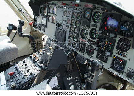 Cockpit with instruments in helicopter of American origin.
