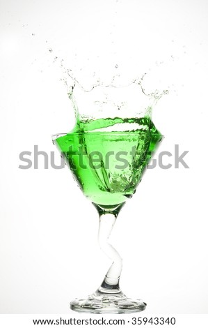 Cocktail and creative splashing . Isolated on white.