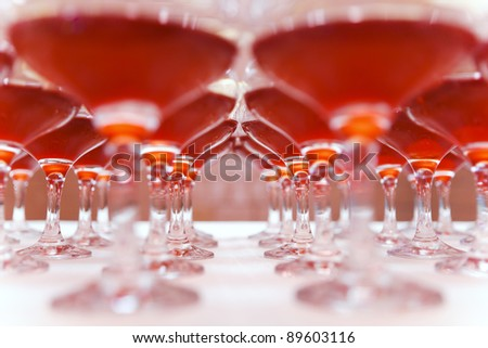 Cocktail classes standing in a row on the table. - stock photo
