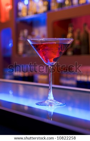 cocktail drink on a bar, blurry background - stock photo