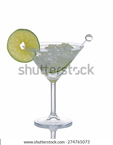 Cocktail drink with stir stick and lime slice isolated on white with reflection.