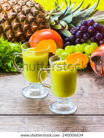 Cocktail fruit antioxidant  with ice cubbe and leaf mint on wooden background  - stock photo