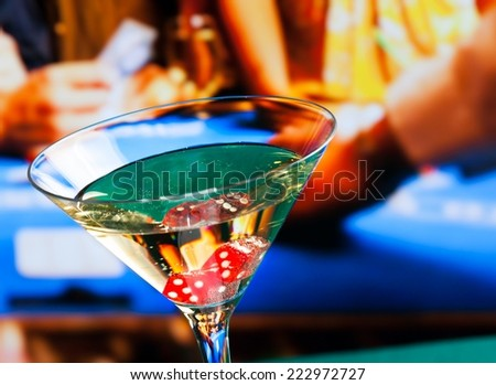 cocktail glass in front of gambling table, casino concept