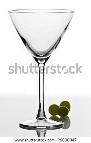 cocktail glass isolated on white ground with three green grapes