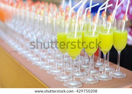 Cocktail glasses with party on beach