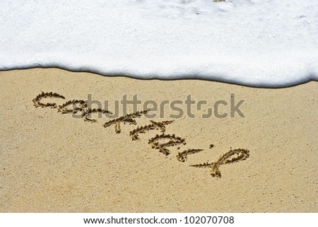 Cocktail hand written in the sandy beach - stock photo