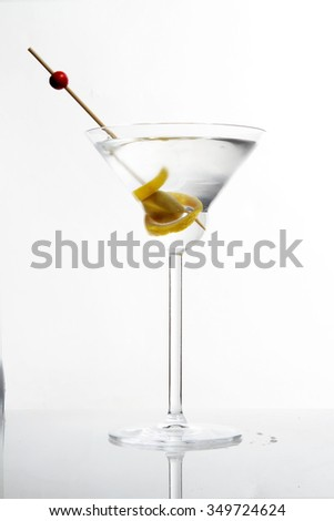 cocktail in martini glass. martini cocktail with a green olive on white background - stock photo