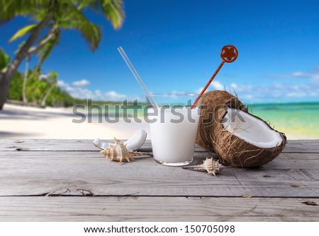 cocktail made with coconut as background a tropical landscape - stock photo