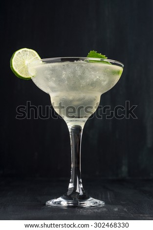 Cocktail margarita on the dark background