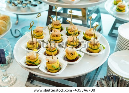 Cocktail meeting party with food egg roll with shrimp decorated - stock photo