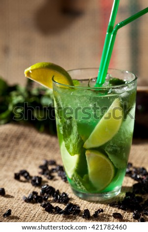 Cocktail Mojito with Lime and Mint - stock photo