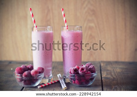 Cocktail of frozen strawberries and  raspberries with yogurt  - stock photo