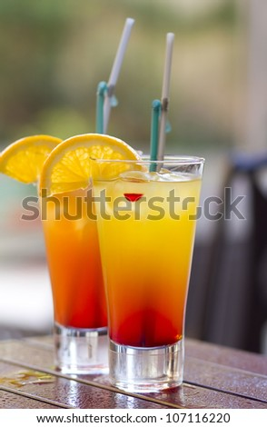 Cocktail on wet table - stock photo