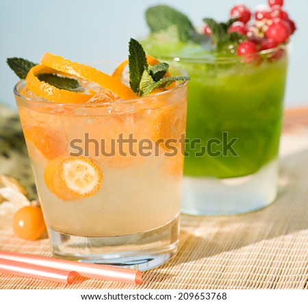 Cocktail on wooden planks - stock photo