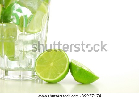 cocktail or lemonade with sliced lime fruit - stock photo