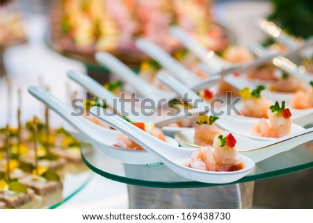 cocktail party decoration with shrimp in spoon - stock photo