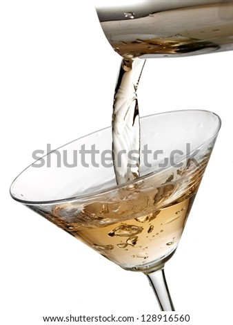 Cocktail pouring in a martini glass - stock photo