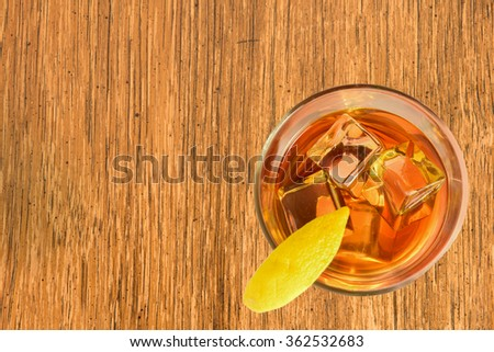 Cocktail, right, with Lemon on bamboo board
