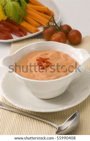 Cocktail sauce in a white bowl. Salad and seafood dressing.